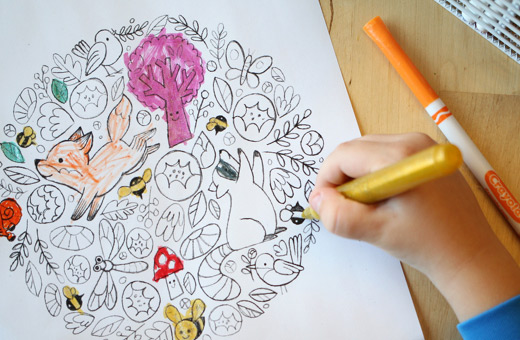 Coloring on a nature themed coloring sheet