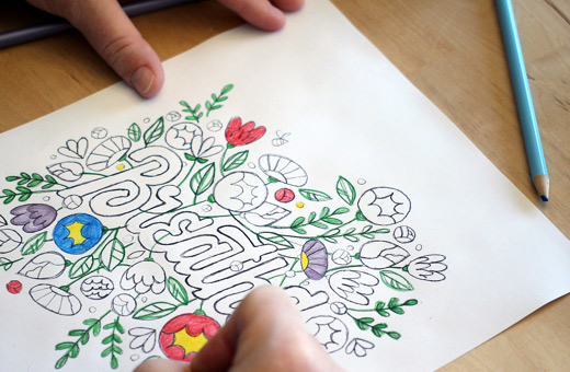 Coloring on a Breathe nature themed coloring sheet